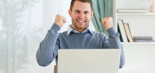 businessman-celebrating-success-in-his-homeoffice